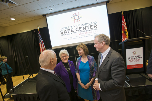 State Treasurer Nancy Kopp, SAFE Center founder and director Susan Esserman, Senator Ben Cardin, and another man conversing after the event. SAFE (safe) Center Opening Event in Stamp Student Union